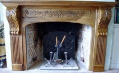 Habillage d'une cheminée dans le sentiment Louis XVI